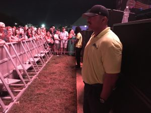 Security personnel guarding stage